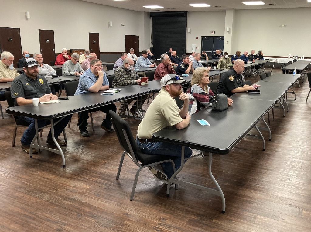 Representatives of agencies in the Unified Command listen to reports.