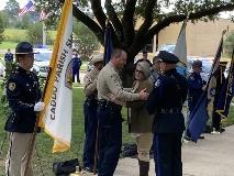 Webster Parish Sheriff Jason Parker with the widow of slain Deputy Billy Collins Jr.