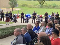 Motorcycle officers stand at attention during the ceremony.